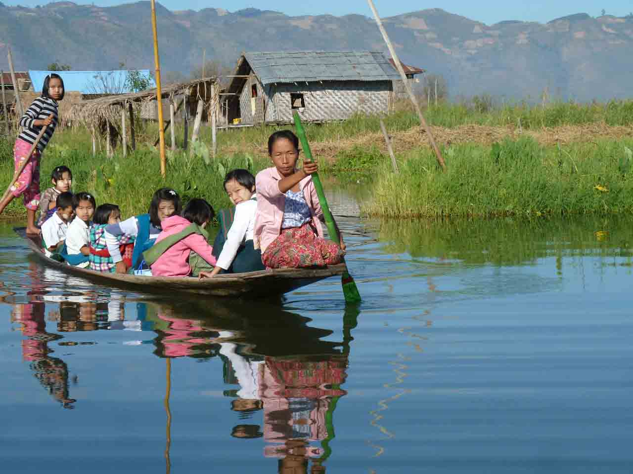 Amberlair Crowdsourced Crowdfunded Boutique Hotel Myanmar - On the Inle Lake in a long boat